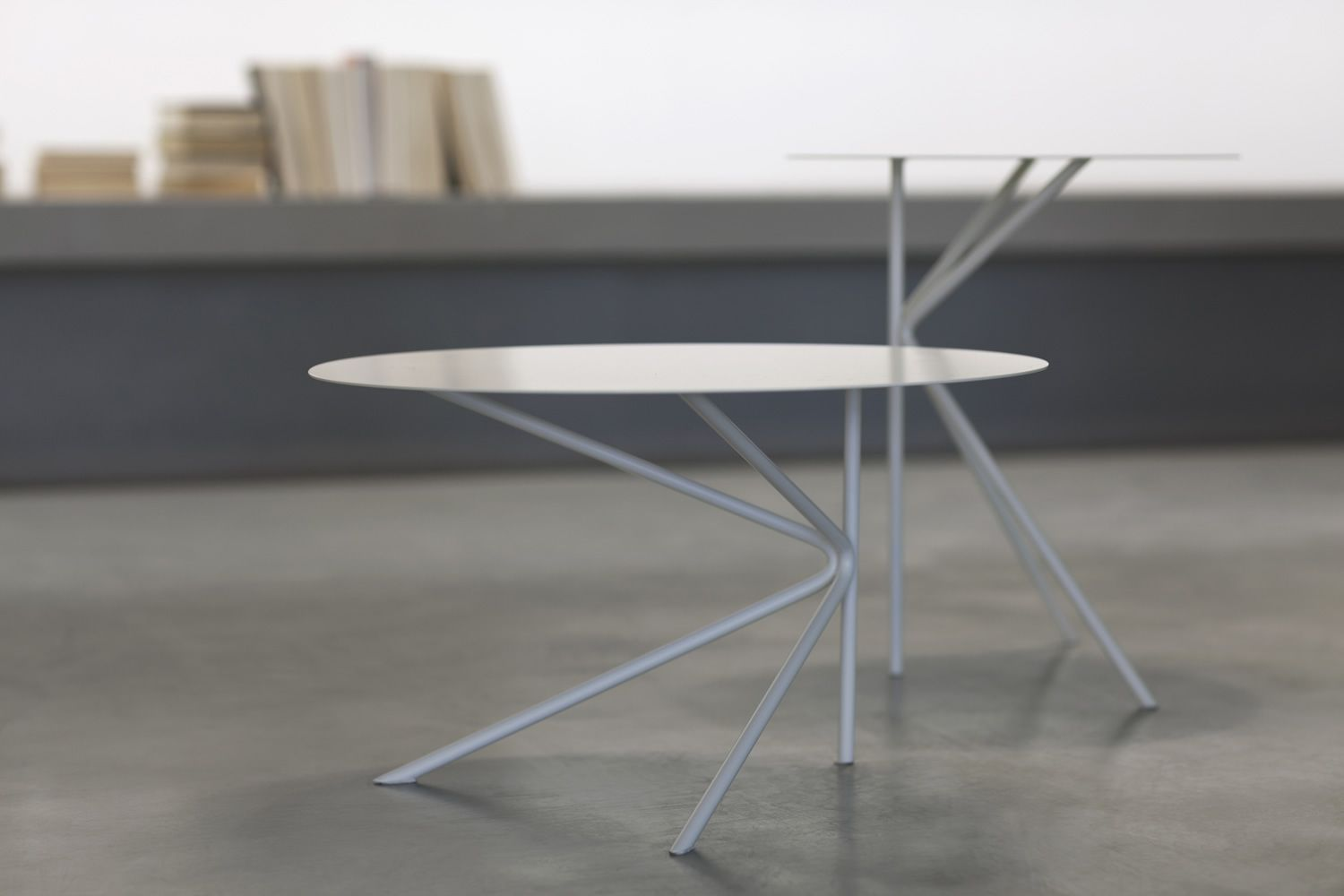 Small round table in lacquered metal, available in two different heights