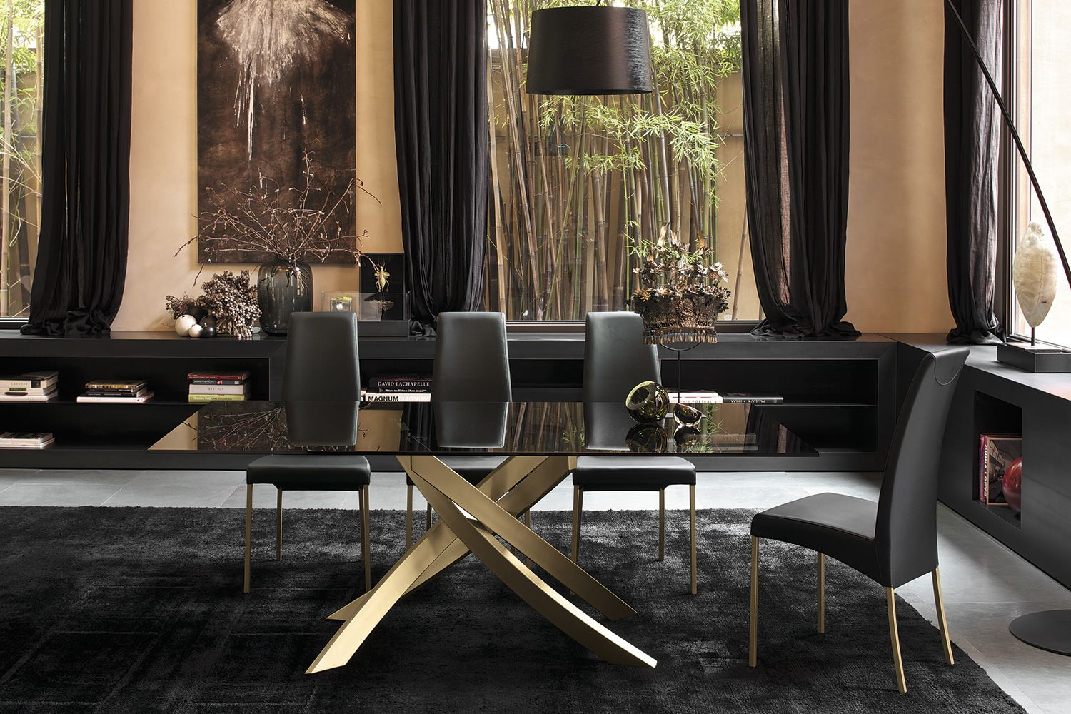 Table with gold lacquered pedestral and top in glossy black lacquered glass