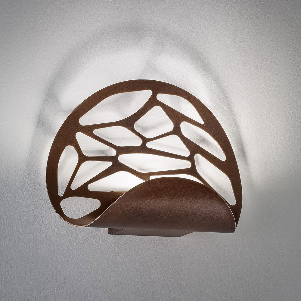 Wall lamp design, in coppery bronze metal