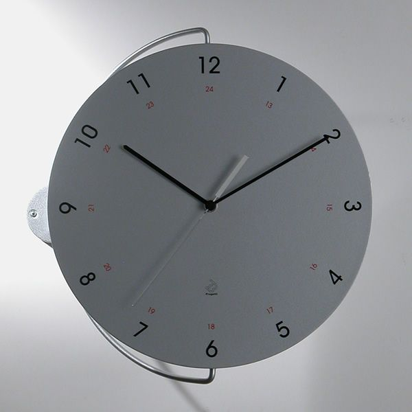 Wall clock in steel and wood