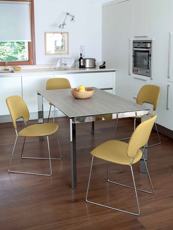 Extendable table made of chromed metal with antique oak melamine top