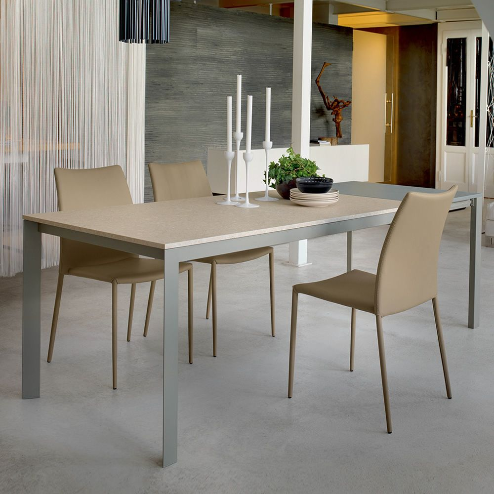 Table in sand lacquerd metal and top in Nanto's stone Unicolor