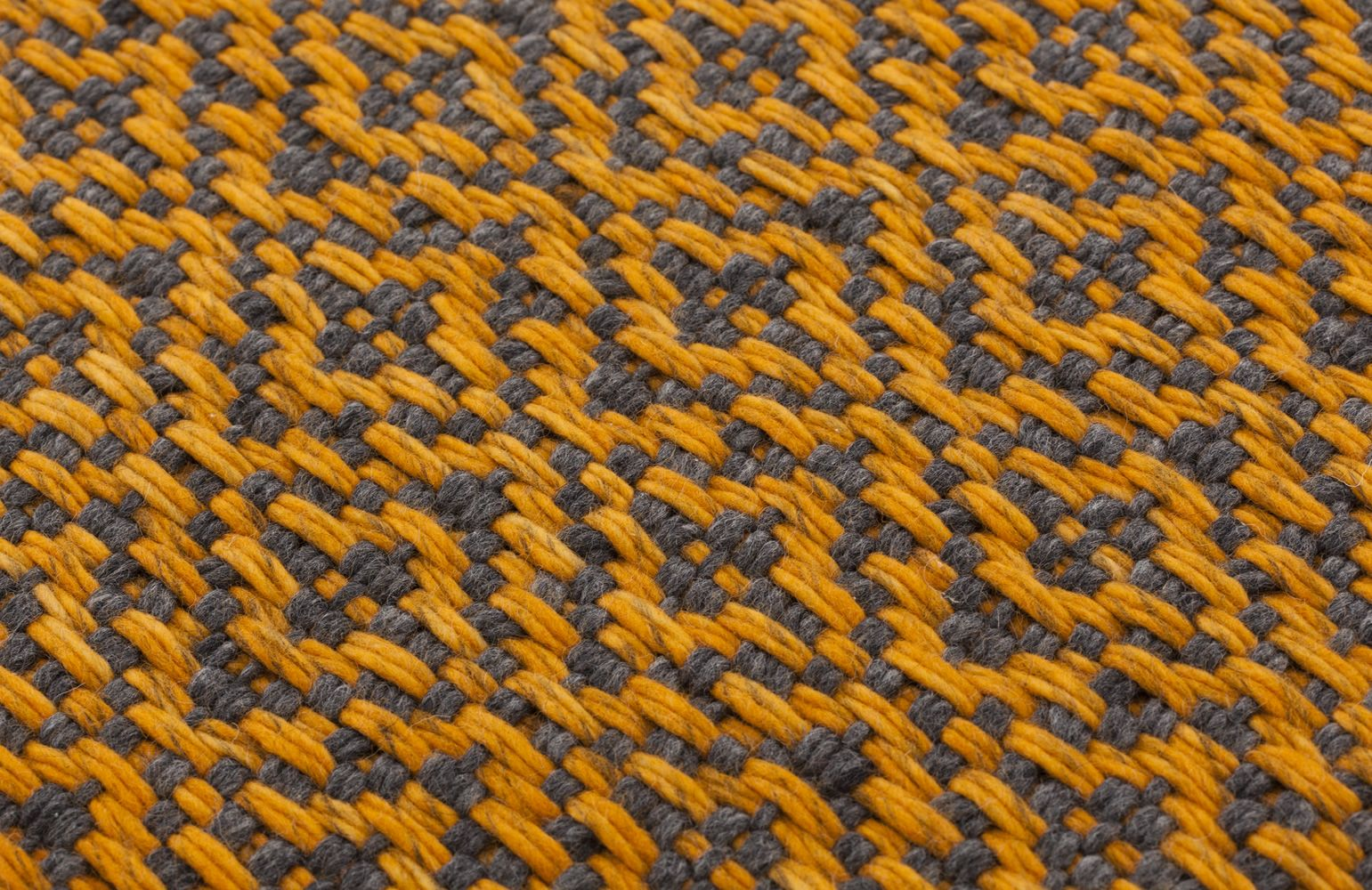 Detail of the rug in orange colour